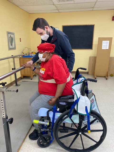 nurse helping patient out of wheelchair